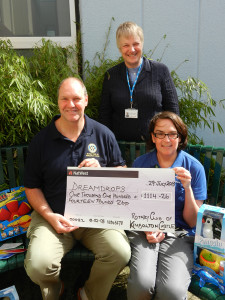 Stuart Silby, past president of the Rotary Club of Kimbolton Castle presenting Mags Hirst, Play Specialist for Cambridgeshire Community Services NHS Trust and Anne-Marie Hamilton, Dreamdrops Chairman with a cheque for more than £1,100 for toys for children with special care needs