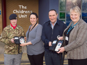 Presentation of sats machine to dreamdrops charity by the RAF Wyton Charities Fund
